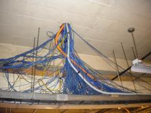 Large Tangle of Electrical Wiring coming from Duct